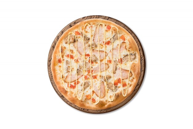 Traditional italian pizza with bacon, tomatoes and cheese sauce on wooden board isolated