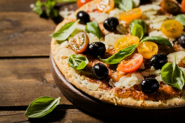 Traditional italian pizza on wooden table