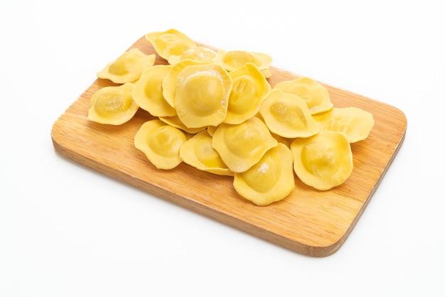 Traditional italian ravioli pasta on white background