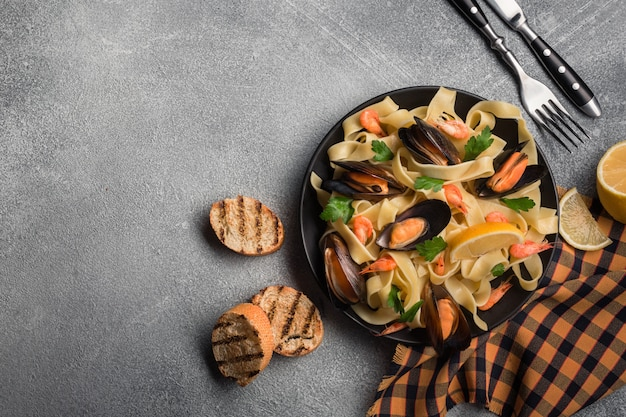 Traditional italian seafood pasta with clams spaghetti alle vongole on stone background