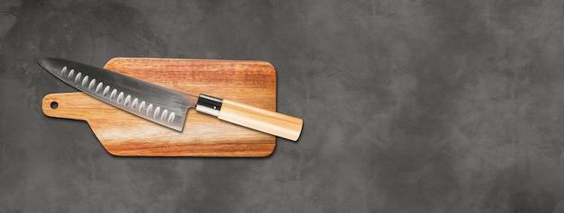 まな板に日本の伝統的な牛刀。具体的な背景バナー