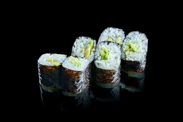 Traditional japanese maki sushi roll withs with avocado. close up
