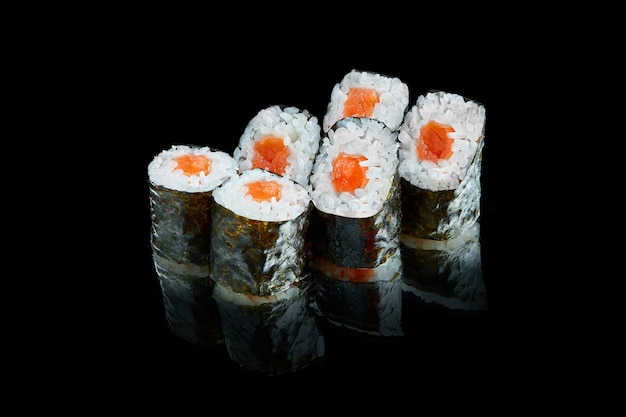Traditional japanese maki sushi roll withs with salmon. close up