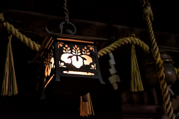 Traditional japanese wooden lamp at night