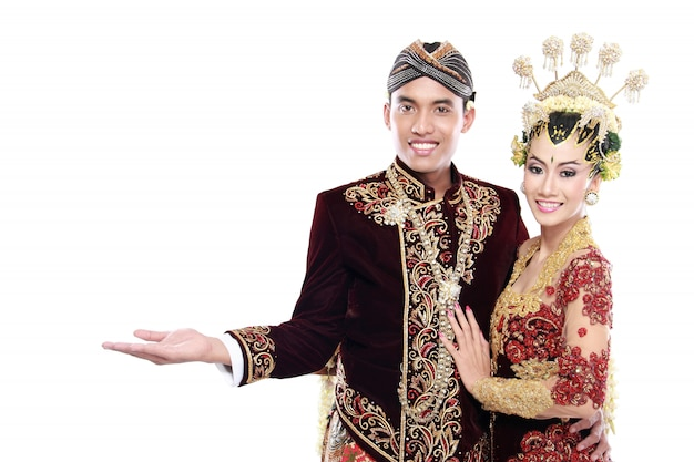 Traditional java wedding couple husband and wife presenting blank area