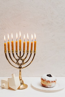 Traditional jewish candleholder burning