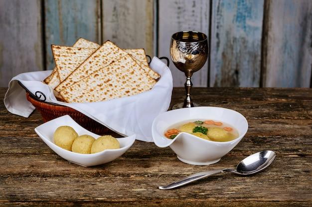 Traditional jewish matzah ball soup, dumplings made from matzah meal - ground matzo.