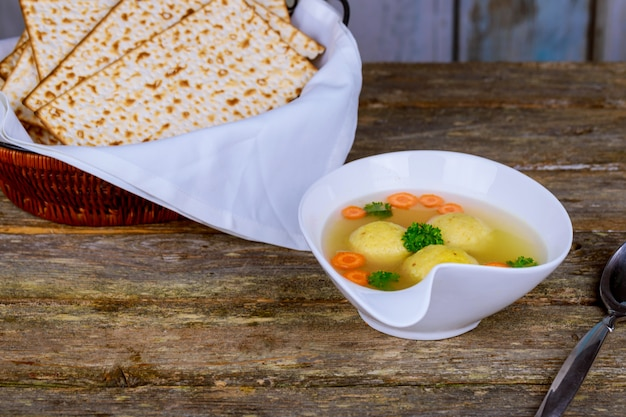 Traditional jewish passover dish matzah ball soup served with