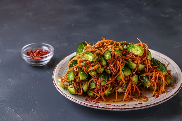 Traditional korean cucumber kimchi snack: cucumbers stuffed with carrots, green onions, garlic and sesame, fermented vegetables, horizontal photo