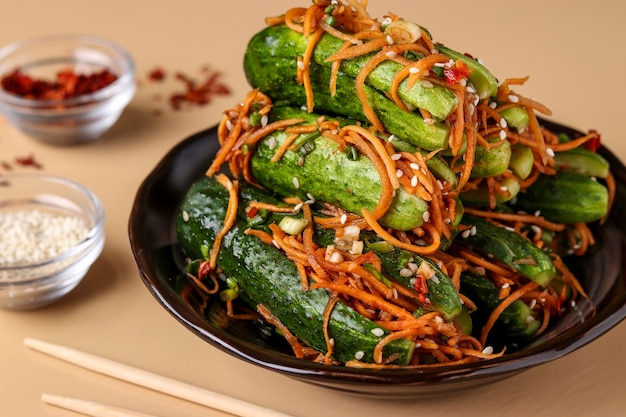 Traditional korean cucumber kimchi snack: cucumbers stuffed with carrots, green onions, garlic and sesame, fermented vegetables, light surface, horizontal orientation