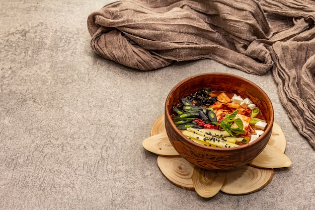 Traditional korean spicy soup with kimchi, tofu, vegetables. hot dish for healthy meal