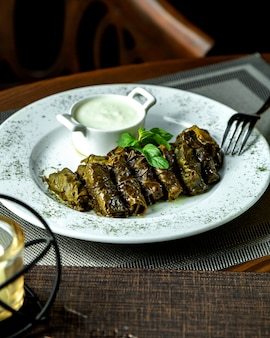 Traditional leaves dolma with sour yogurt
