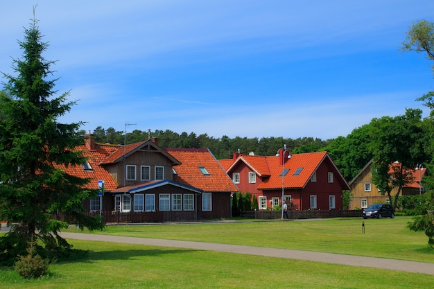 Traditional lithuanian wooden and half-timber houses in the countryside. juodkrante village