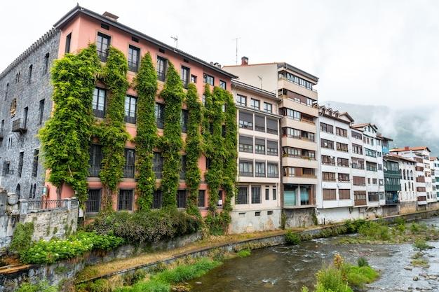 Traditional local houses in the town of azkoitia next to the urola river, gipuzkoa. basque country
