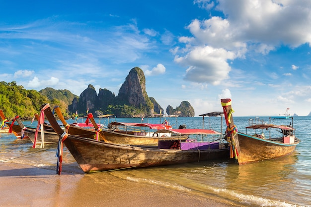 Traditional long tail boat on railay beach in krabi in thailand