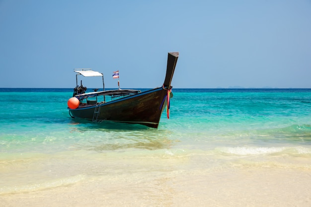 Traditional longtail boat on the tropical beach near koh phi phi island, thailand