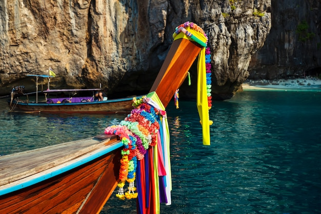 Traditional longtail boat on the way to famous maya bay beach in koh phi phi island