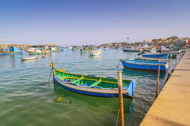 Traditional maltese fisherman boats luzzu in marsaxlokk bay in malta.