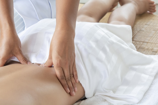 Traditional medicine  women massage therapy and treatment. aches and muscles. pain