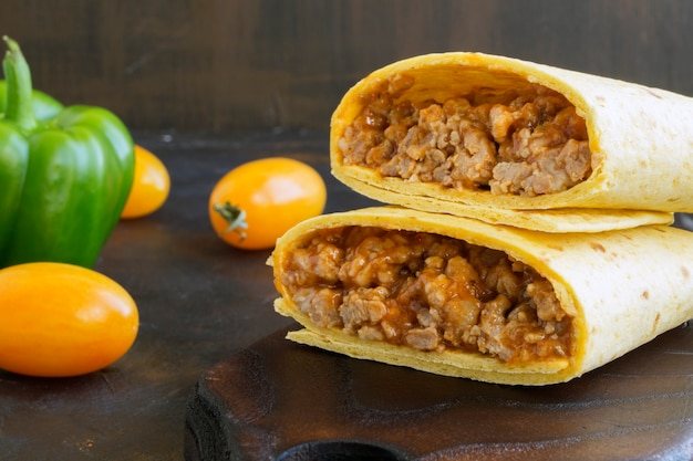 Traditional mexican dish, burrito with minced meat