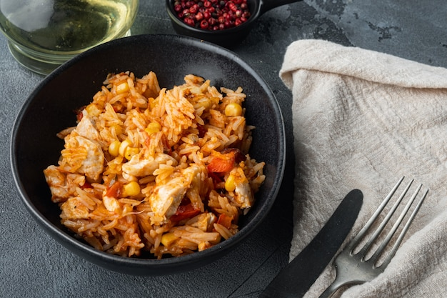 Traditional mexican enchiladas with chicken meat, rice and cheese mexican cuisine., on gray table