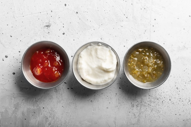 Traditional mexican sauces on the gray concrete table
