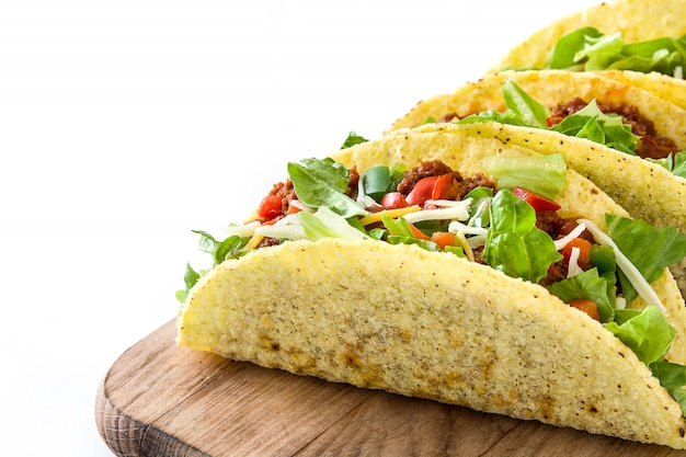 Traditional mexican tacos with meat and vegetables isolated on white