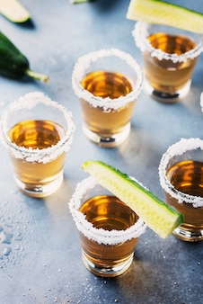 Traditional mexican tequila with cucumber