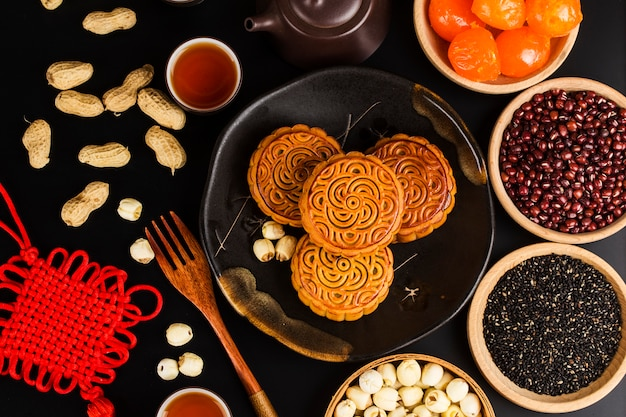 Traditional mooncakes on table setting with teacup.