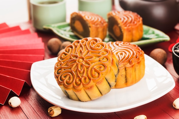 Traditional mooncakes on table with teacup