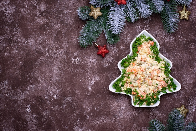 Traditional new year russian salad olivier in shape of tree