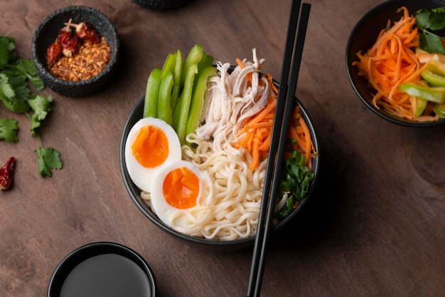 Traditional noodles in bowl with eggs and vegetables