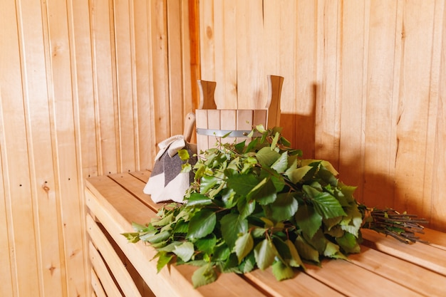 Traditional old russian bathhouse spa concept interior details finnish sauna steam room with traditi...