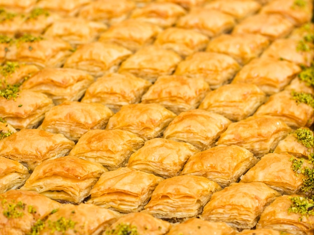 Traditional oriental dessert - baklava with pistachios and walnuts. isolated