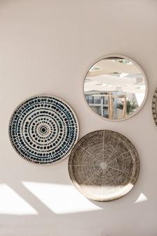 Traditional oriental ornamental ceramic plates on white wall.
