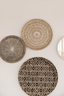 Traditional oriental ornamental ceramic plates on white wall