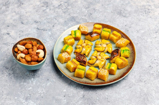 Traditional oriental sweets with different nuts on concrete surface