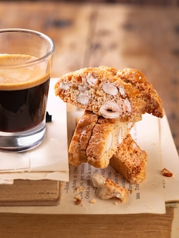 Traditional pastries, italian homemade biscotti cookies or cantuccini, with almonds nuts and coffee.