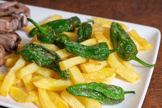 Traditional patatas bravas with peppers spanish potato appetizer tapas