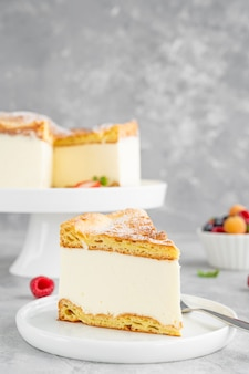 Traditional polish cake karpatka cake of choux pastry dough and custard cream with fresh berries