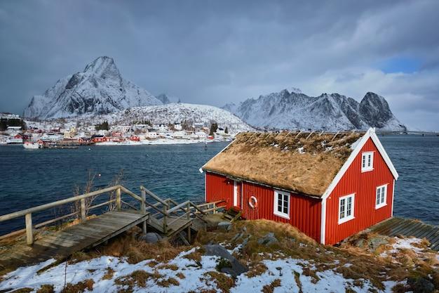 Traditional red rorbu house in reine village on lofoten islands,