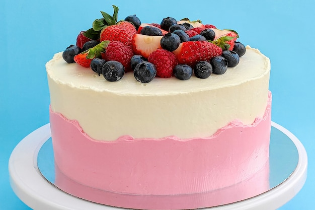 Traditional red velvet cake decorated with strawberries and blueberries