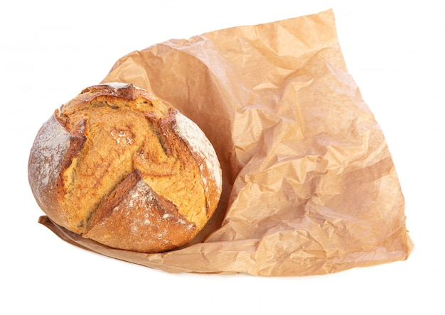Traditional round bread on brown paper