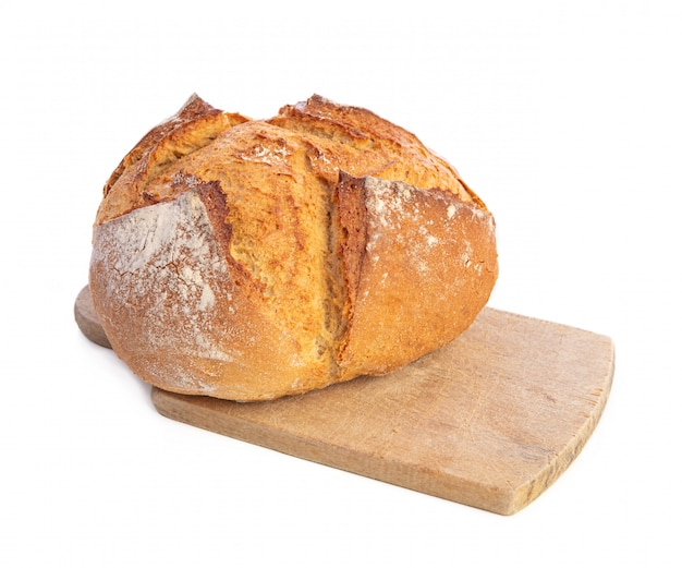 Traditional round bread with cutting board