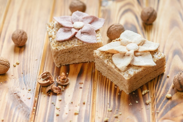Traditional russian dessert - pastila and hazelnuts on rustic wooden background.