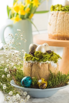 Traditional russian easter cottage cheese dessert, orthodox paskha on  table with kulich cakes, flowers, colored eggs.