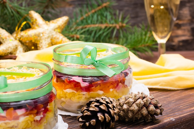 Traditional russian salad, herring under a fur coat in bowls