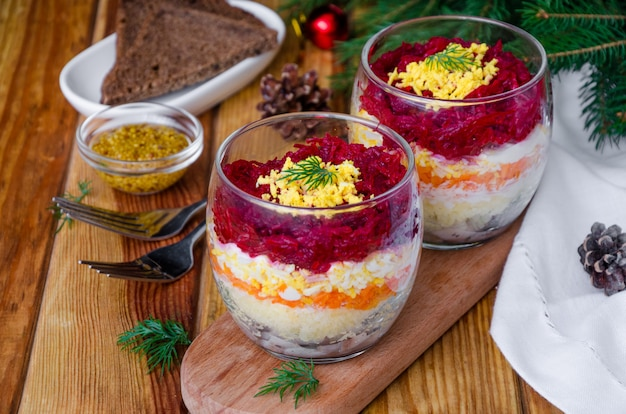 Traditional russian salad herring under a fur coat in a glass
