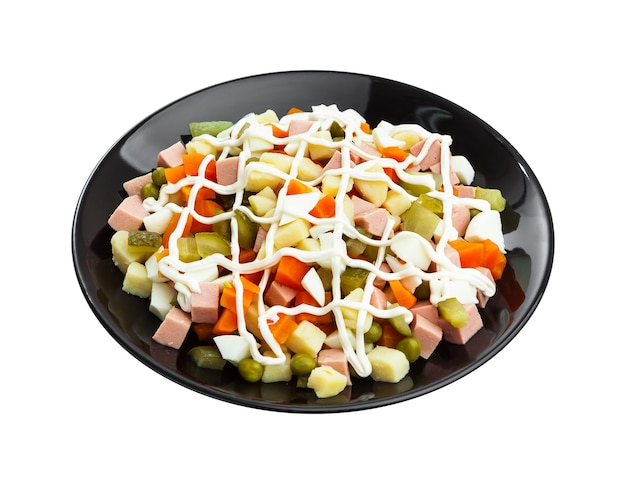 Traditional russian salad olivier isolated on white background with clipping path