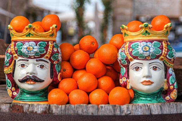Traditional sicilian ceramic heads with oranges